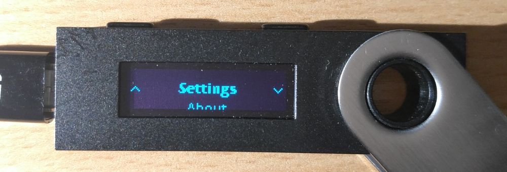 Image of Ledger device open to 'Settings'